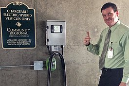 Kevin Weaver, Community Regional's director of security, gives the new electric charging stations a thumbs up.