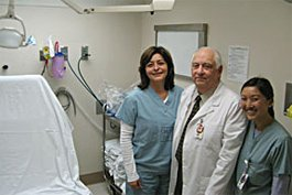 Stanley Surabian, D.D.S. standing with dental residents, Dr. Rosaura Pacheco (left) and Dr. Regina Nguyen (right).