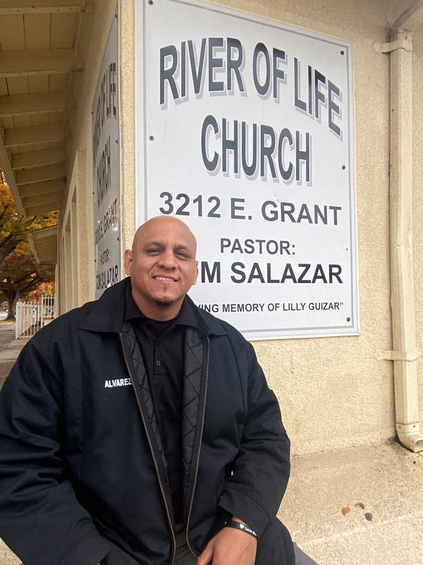 Armando Alvarez sitting in front of the River of Life Church