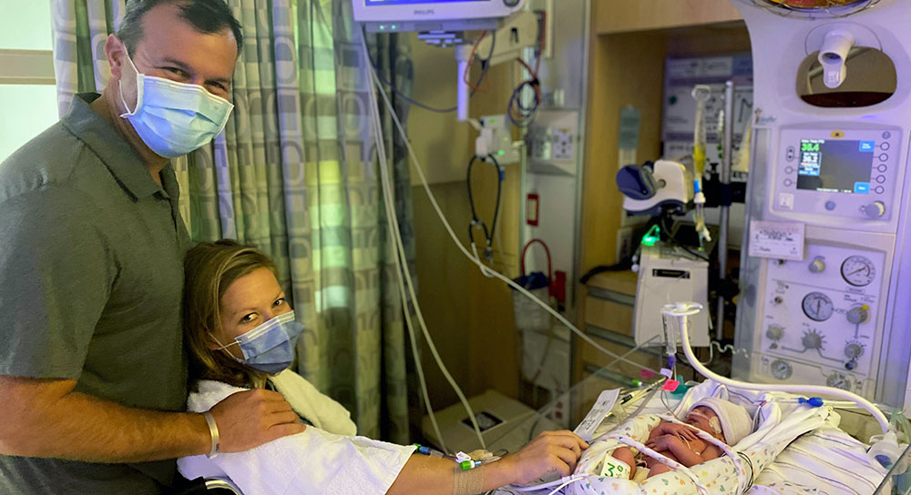 Father and mother in NICU with newborn son