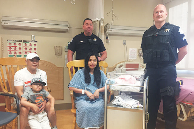 Fresno Police Officers reunite with baby boy they helped deliver